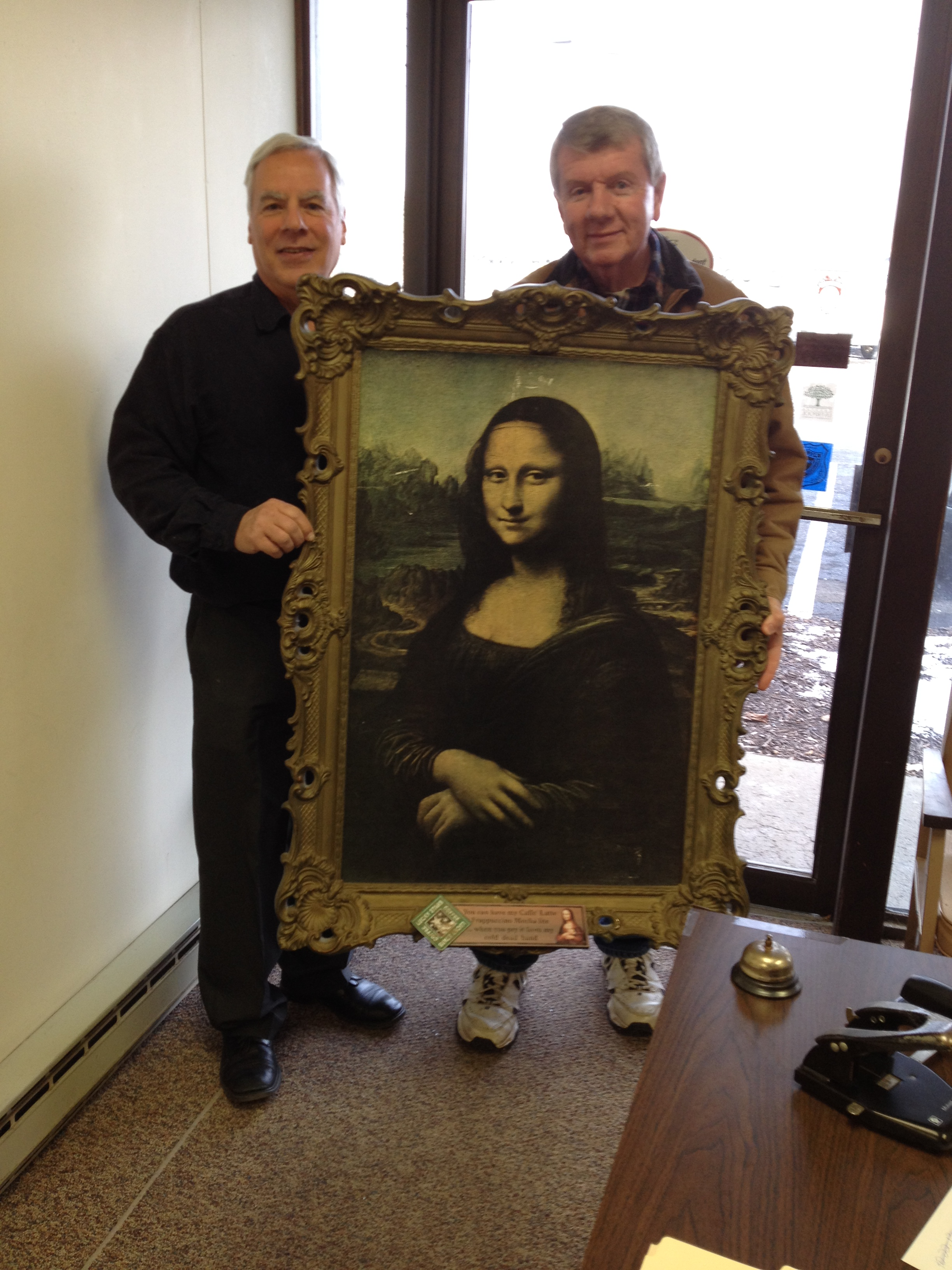 """We were honored to receive a visit from the """"Mona Lisa"""" today!  Thank you to our client Tom Barry (pictured right) for a view of his """"one-of-a-kind"""" masterpiece."""